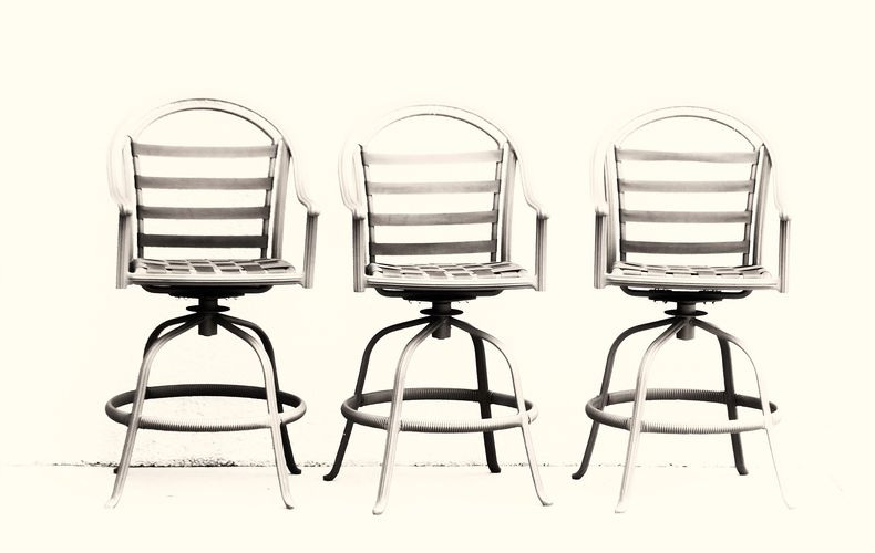 Contemporary, high key, minimalist photograph image of three chairs.
