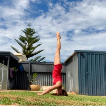 Headstand yoga core work in our inversions and hand balancing yoga classes in Fremantle.