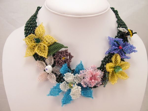 Beaded flowers on a bead netted base Think Spring.