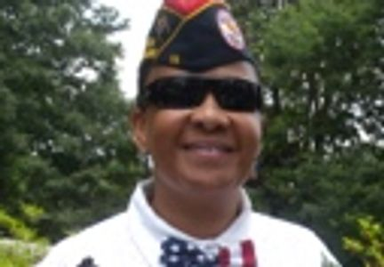 female with BVA Chapter Officer hat. Wearing black shades, white shirt, and red, white, blue bowtie.