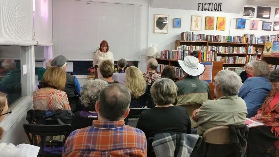 Eileen giving a reading at a bookstore