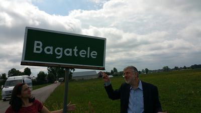 Shlomo and Shoshana under the sign to Bagatele, Sam's home town