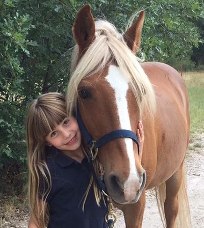 Little girl in love with a lovely pony!