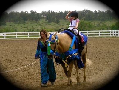 Dressed for a dream ride on a beautiful palomino horse.