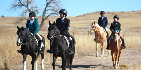 EquesTraining students riding home after Bijou Springs hunt.