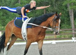 Vaulter demonstrating a correct flag move on a cantering horse.