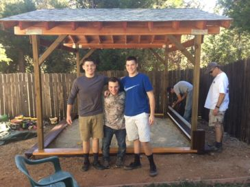 Eagle Scout Chase & Company working on the sandbox.