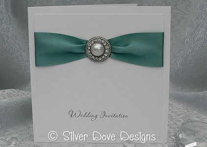 Side fold wedding invitation with satin ribbon and large pearl and diamante embellishment