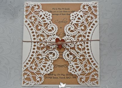 Laser cut doily rustic wedding invitation finished with wooden heart and twine