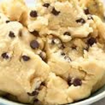 Edible chocolate chip cookie dough in a bowl.