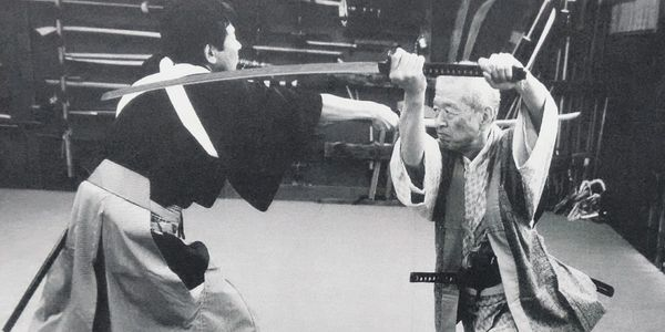 Soke Hatsumi demonstrating Kiri age (rising cut).
