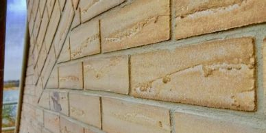 Brick slip design on to External Wall Insulation, 90mm EPS insulation applied, Sand Acrylic Brick slips to finish