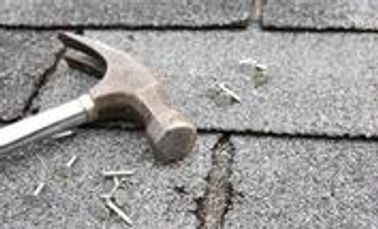 picture of a hammer and nails on a roof in bradenton florida