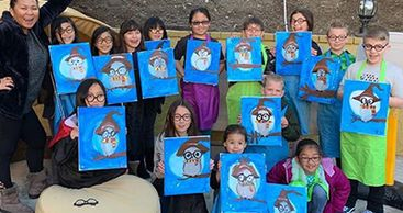 These kids were eating and drinking while learning how to paint Harry Potter's owl. A fun activity for a birthday party.