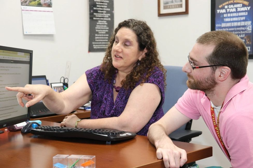 Sandy Weitkamp discusses public benefits with Matt, a student at the BCI Skills Center.