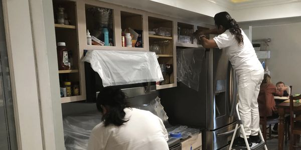Repaint Florida crew refinishing & painting kitchen cabinets in Merritt Island Fl 32952