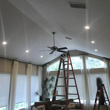 Recessed lights installed on vaulted ceiling