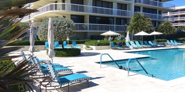 Meridian, 3300 South Ocean Blvd., Palm Beach, condos for sale, pool with chairs and trees