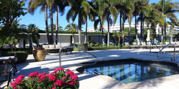 2500 Building, 2500 South Ocean Blvd, Palm Beach, pool with cabanas and flowers