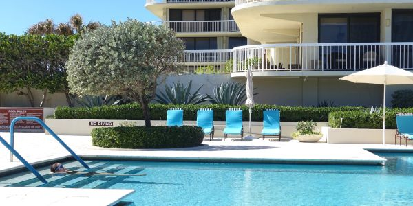 Meridian, 3300 South Ocean Blvd., Palm Beach, condos for sale, pool with four blue chairs