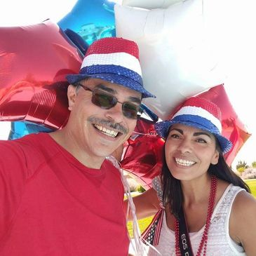 Jose V. Sanchez, CFP® is an independent financial advisor in Albuquerque New Mexico and he loves celebrating independence with his wife at their community parade.