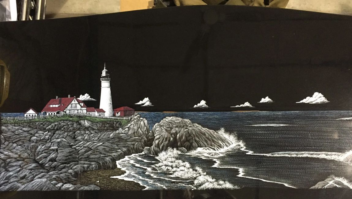 Full lighthouse scene hand color etching on a large black upright memorial