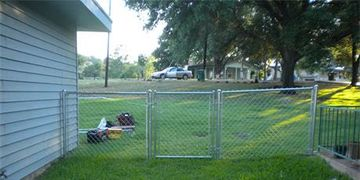 Four foot tall residential chain link fence with a chain link gate installed in Austin  TX.