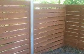 Horizontal wood privacy fence is a growing trend among Austin homeowners.
