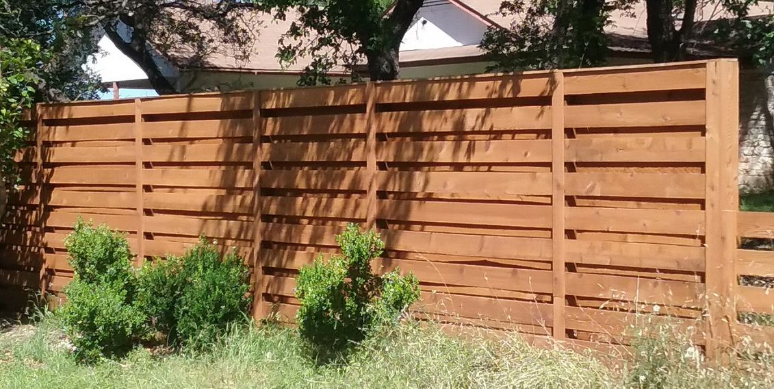 Wood fence installed by Landmark Fence Company Austin. Horizontal shadow box privacy fence