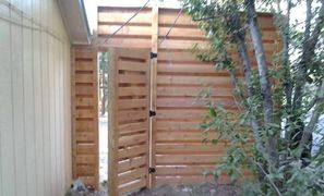Ten foot tall horizontal shadow box privacy fence in Austin Texas. The ultimate wood fence