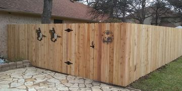 "Our standard cedar privacy fence constructed with 5/8"" thick 6"" wide western red cedar pickets"