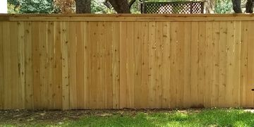 Cap and Trim wood fence installation in Austin TX. Add a decorative look with a cedar cap