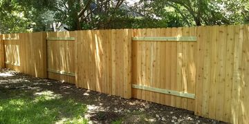 Good neighbor fence in Austin constructed by alternating the direction the pickets face every 8'