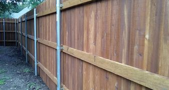 Standard privacy fence with steel posts, three treated rails and cedar fence pickets