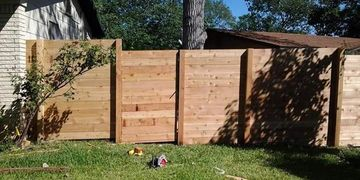 "Horizontal Cedar Privacy fence using western red cedar fence pickets attached to 4""x 4""cedar posts"