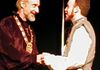 "Polonius  (left- Mort Paterson) encourages his son Laertes  (right - Barry Schechter)  to ""neither a borrower, nor a lender be."""