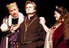"Claudius  (left - Hugh Barton)  urges Hamlet (center- George Hartpence) to ""think of us as of a father"" while Gertrude (Carol Thompson) looks on."