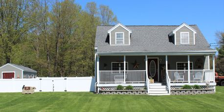 Updated 2+ bed 2 bath Cape w 2 garages, farmers porch, pellet stove & more!