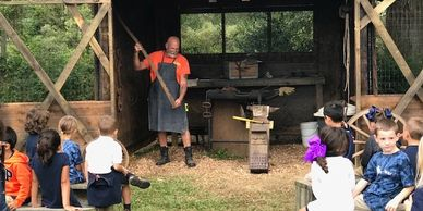 Blacksmith,  1800's train car, pumpkin market and lesson, animal barn, hayride, and more!  $8.50 per