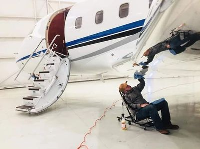 Our owner cleaning a plane detailing aircraft
