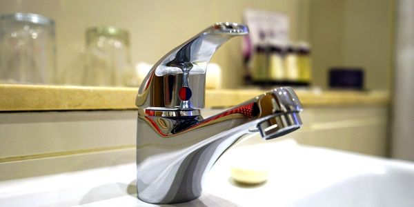 New porcelain sink and single handle chrome faucet installation