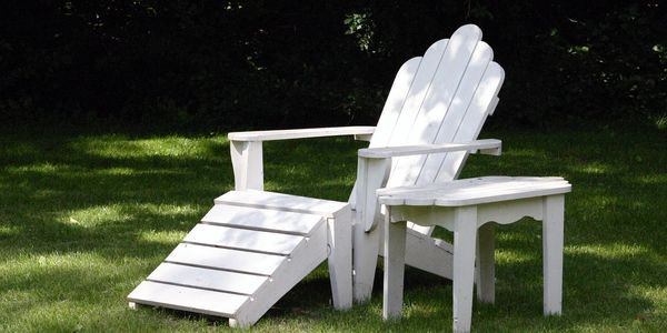 Empty Adirondack chair - relax while we do the work