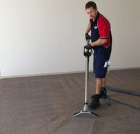 Carpet cleaning technician steam cleaning carpet