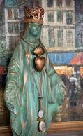 Patina green and copper crowned Mary statue featured wearing Milagros and miraculous medals