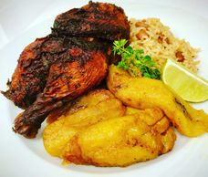 1/2  Caribbean Jerk Chicken  with Coconut  Rice & Peas with Sweet Plantains and Our SignatureMango