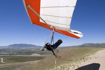 A hang glider pilot swooping in a falcon 4 at Utah's point of the mountain south side flight park