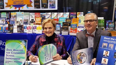 Dr. Bernhardt and Bradley Geise at a book signing at ASCD Empower 18