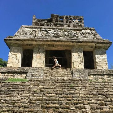 Karen Webb Green in sun warrior pose at the top of the Temple of the Sun pyramid, Palenque,