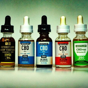 Bottles of CBD oil, from different U.S. companies that we sell on our site.