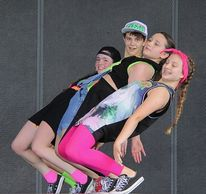 Teens in hip hop costumes dance studio Austin Texas